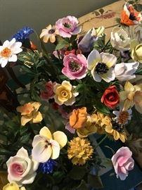 A couple dozen porcelain flowers