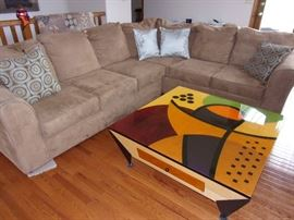 Microsuede sectional excellent condition. Custom made art piece coffee table. Unique conversational piece!