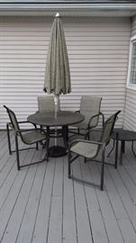 Outdoor dining set with umbrella.