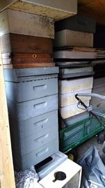 Bee hives and various bee keeping equipment and related gear.