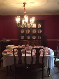 Queen Anne table with two leaves and 6 chairs.