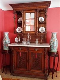 THIS AMAZING CUPBOARD HAS CARVED DETAILS - MARBLE TOP - BRASS HARDWARE.