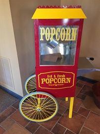"Popcorn popper machine maker. Measures about 4' 7"" high, 2' 7"" wide, 19"" deep. Movie popcorn fun!"
