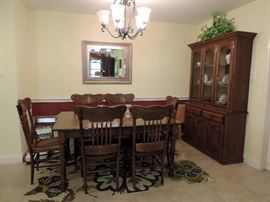 Wooden Dining Table and 6 Pressed Back Oak Chairs and Lighted China Cabinet