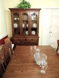 Wooden Dining Table and 6 Pressed Back Wooden Oak Chairs and Lighted China Cabinet