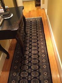 Hall carpet runner, black and off white.