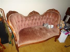 AMERICAN VICTORIAN ROCOCO CIRCA 1870'S  HIGHLY CARVED WALNUT CARVED FRUIT. TUFTED BUTTON UPHOLSTERY