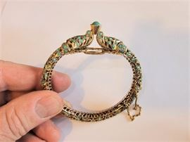 14kt GOld with Turquoise. 1.46 oz total weight Extremely intricate Bracelet. Very secure clasp. Asian styling.