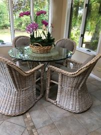 Amazing Wicker patio table with glass top, great inside and out. American Made!!!! with 4 comfy chairs $500 presale Price