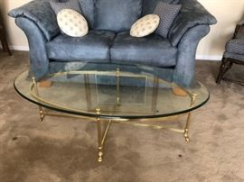 Glass and Brass footed oval table great for entertaining inside and out