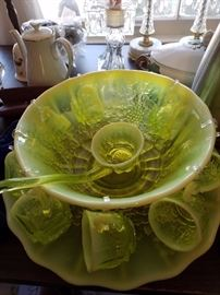 Beautiful rare vaseline glass punch bowl with cups and ladle and plate. Rare to find!!