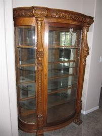 Available before sale. Oak curved glass display cabinet with great detail.