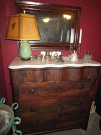 Mahogany dresser with marble top and serpentine drawer.