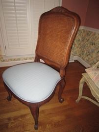 One of 8 double cane back dining side chairs