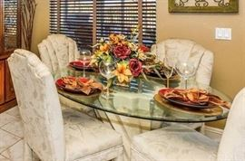 Glass kitchen table & 4 upholstered chairs (priced separately)
