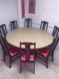 "Very large round dining table. Metal base Formica top.  Excellent condition and perfect for large family.  65"" diameter"