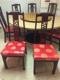8 matching beautiful chairs. Vintage made in Taiwan. Excellent condition upholstery always covered