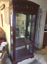 "Beautiful Curio Cabinet. Mirrored back and lighted. Glass shelves. 81"" Tall 35"" Wide 14"" deep"