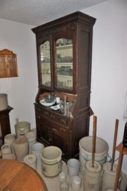 Oak cabinet and crock assortment