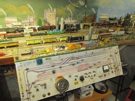 Massive HO model train layout that goes around three sides of the basement.  Everything will be sold piece by piece.