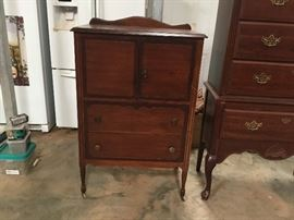 Antique Cabinet. There are 2 slide outs inside the doors & the drawer pulls on the bottom drawer are not original