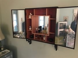 Mirrored interior of hanging cabinet