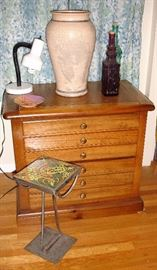 Small chest with tile bed stand, vase and bottles