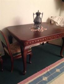 Antique/Vintage Queen Anne style dining table with four chairs and two extensions.