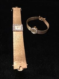 14 karat gold ladies watches with diamonds by Concord.