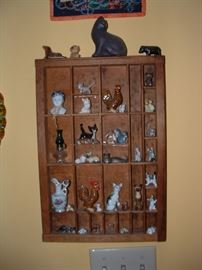 Neat shelf of animal collectibles