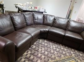 Leather sofa pit with end reclining chairs