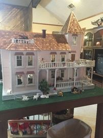 This is a doll house any little girl or big girl would be so happy with.  My client built this farm house, doll house form a kit.