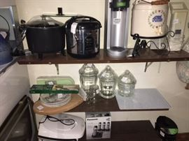 various kitchen appliances with glass containers and other kitchen itmes