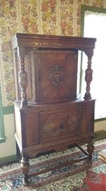 $175  Tall carved wood cabinet