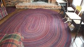 "$75   Oval braided rug    137"" x 102"""