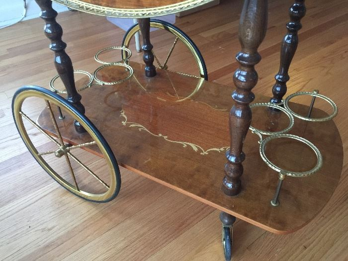Beautiful tea cart with fold down sides...inlay wood...wine bottle holders on the bottom.  Made in Italy