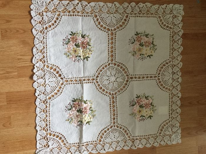 small crocheted and embroidered table cloth