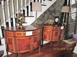 Pair of Demi-Lune cabinets.