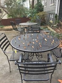 Two Charleston Forge outdoor dining sets.