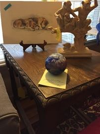 Note the side table's carving.  James Lundberg Studios glass paperweight of the world, signed and numbered.