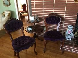 A pair of velvet accent chairs.