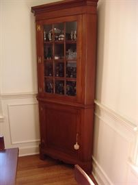 Second mahogany corner cabinet with glass door and shelves