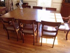 Mahogany dining table and 8 chairs, circa 1950