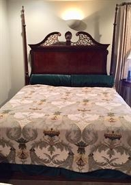 Two poster king size bed with a tapestry-style cover