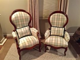 Pair of vintage arm chairs with matching upholstery