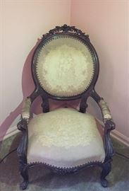 Antique arm chair with needle point upholstery