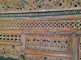 Close up of carved headboard