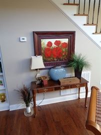 sofa table and poppies painting
