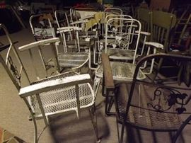 multiple iron patio chairs from the warehouse