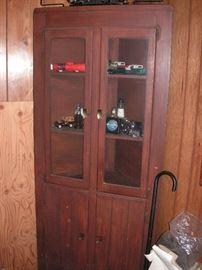 Corner cabinet w/Avon car bottles
